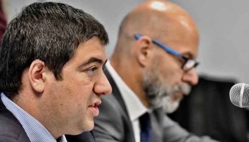 Los fiscales Alex Williams y Omar Rodríguez.