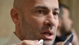 Escracharon al ministro Massoni mientras hacía gimnasia
