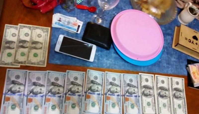 Pesos y dólares secuestrados.