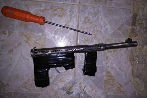Arma secuestrada.