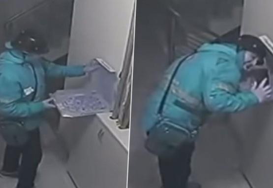 Captura de video del momento en que el repartidos escupe la pizza antes de entregarla.