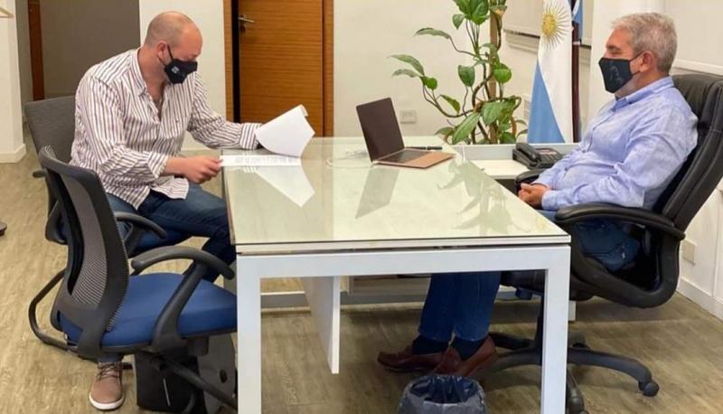 Dario Menna junto a Aníbal Fernández.